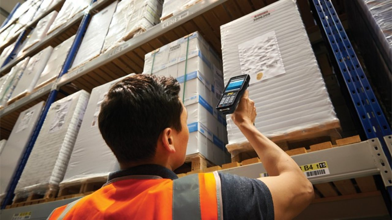 Man scanning in warehouse