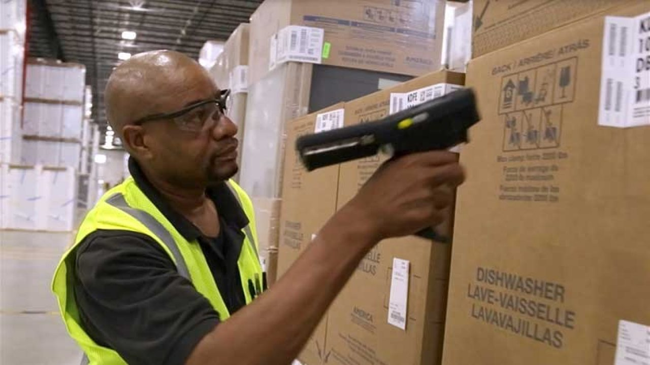 Worker scanning cardboard box