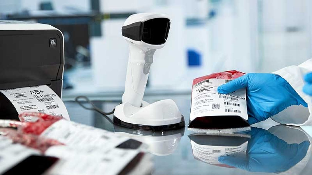 healthcare scanner and desktop wristband printer in use at workstation counter