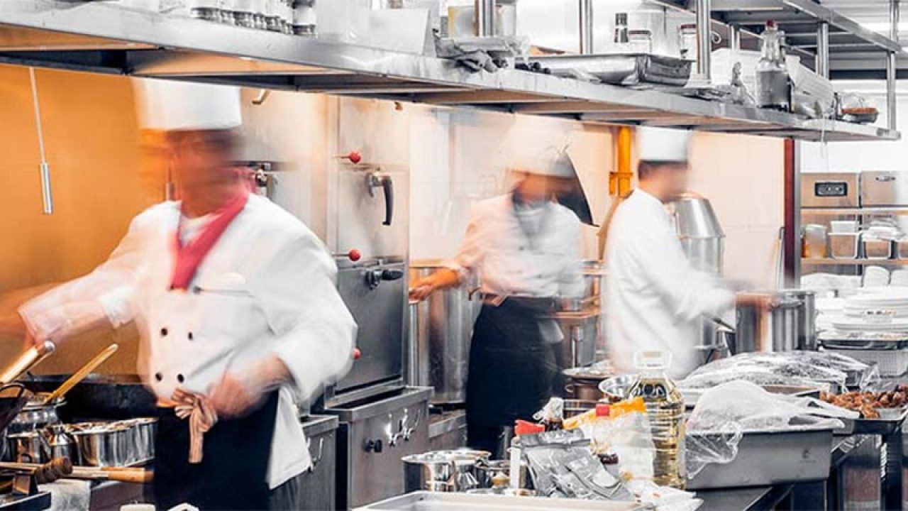 Chefs cooking in a restaurant kitchen