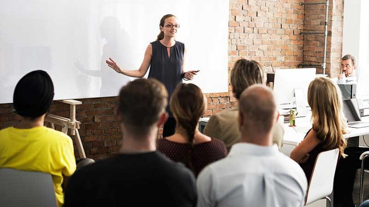 Woman teaching in front of a class