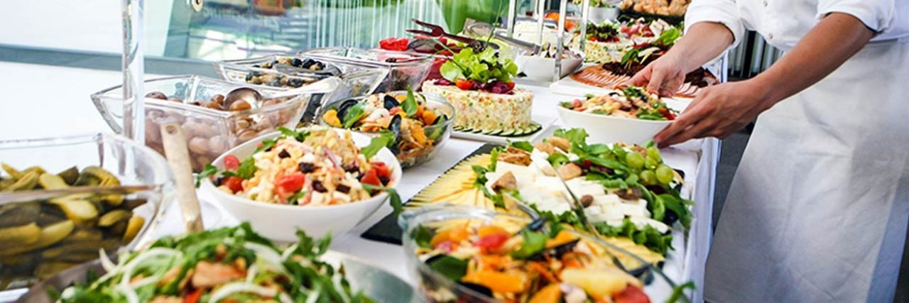 buffet table of food and beverages for an event