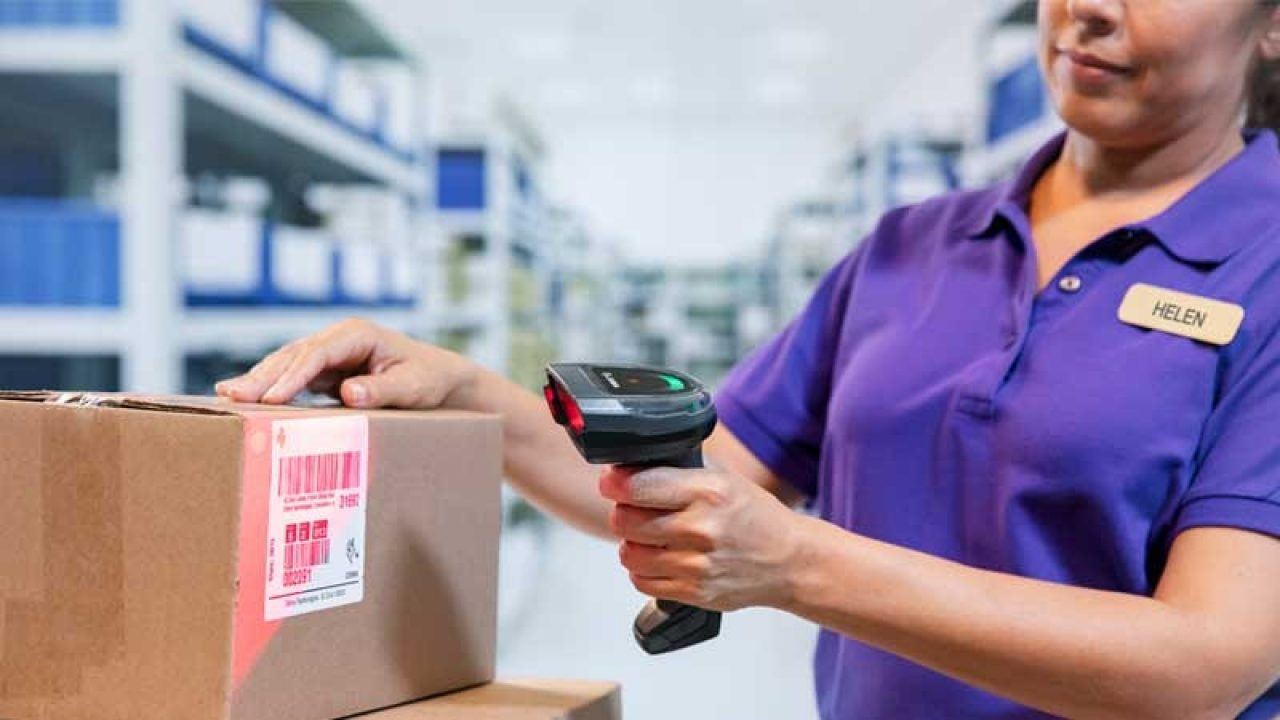 Employee scanning a box using a Zebra scanner.