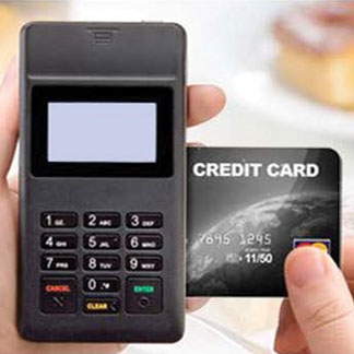 Zebra PD40 mobile payment device, shown swiping a credit card